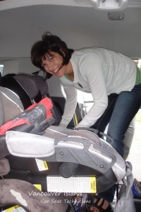 Certified Children's Restraint Systems Technician Laura Hagen attempts to install three car seats across the back seat of an SUV.  A challenge, but ultimately a success!