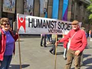 Humanist Society of Victoria President Rosslyn Ives and Secretary Stephen Stuart holding Humanist Society of Victoria banner outside State Library in Melbourne for March for Science rally on 22nd April 2017