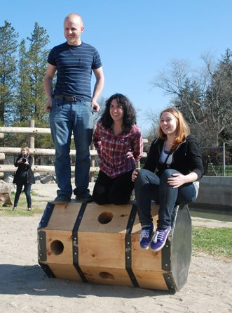 "Alex Stoltze, Jaclyn Bonzagni and Holly Kelly atop the ""octo-log."" (Susan Hagner for WBUR)"