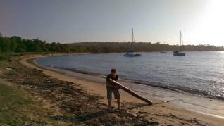 Jibbon Beach: Richard Drags a Log