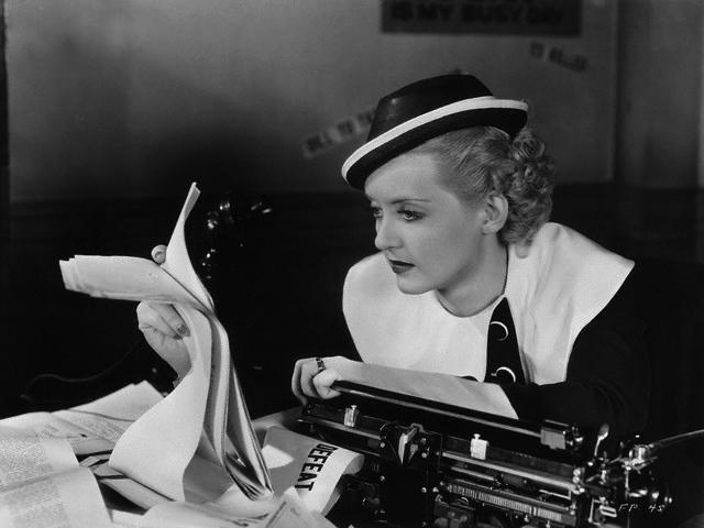 Actress Bette Davis Sitting at Typewriter During Scene
