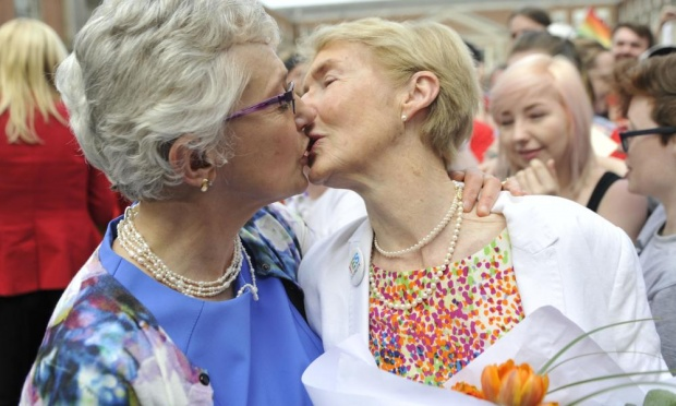 Senator Katherine Zappone and her partner Ann Louise Gilligan kiss as they join the crowd celebrating the yes vote outside Dublin castle on Saturday. Photograph: Clodagh Kilcoyne/Getty Images