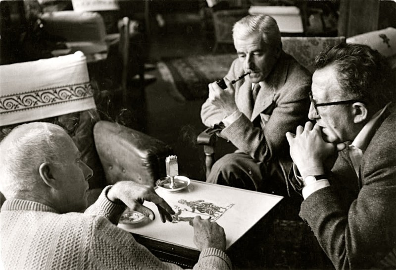 Robert Capa photo of: Howard Hawks, William Faulkner, and screenwriter Harry Kurnitz