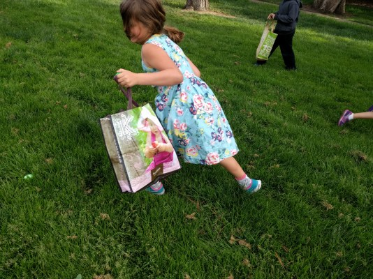 My daughter racing to an egg.