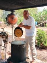 Putting in the fermented corn