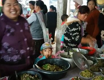 Cheeky little face in Muang La market
