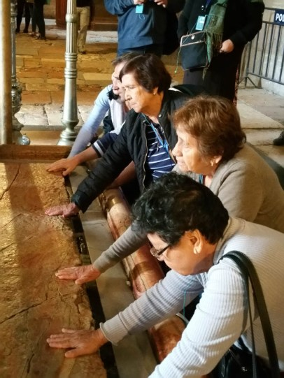 Praying on the slab where Christ's body was laid