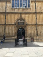 The entrance to the Divinity School with the statue of the Earl of Pembroke in the schools quadrangle