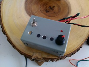 The metal control box with holes for the buttons