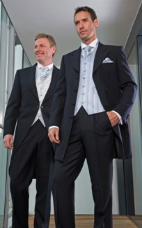 Left: Navy Tailcoat, Navy Trousers, Ice Finesse Waistcoat, Ice Finesse Scrunch Tie Right: Navy Prince Edward, Navy Trousers, Prestbury Blue Waistcoat, Prestbury Scrunch Tie and Handkerchief