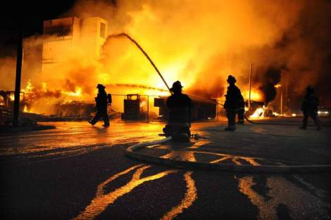 Image #: 36434158    Baltimore firefighters battle a three-alarm fire at Gay and Chester Streets on Monday, April 27, 2015, in Baltimore. It was unclear whether it was related to ongoing riots. (Jerry Jackson/Baltimore Sun/TNS)