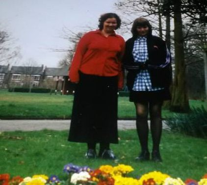 Me at 16 in red with my sister.