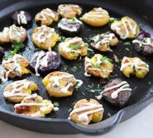 Smashed Potatoes with Spicy Vegan Aioli by @cocoaandsalt