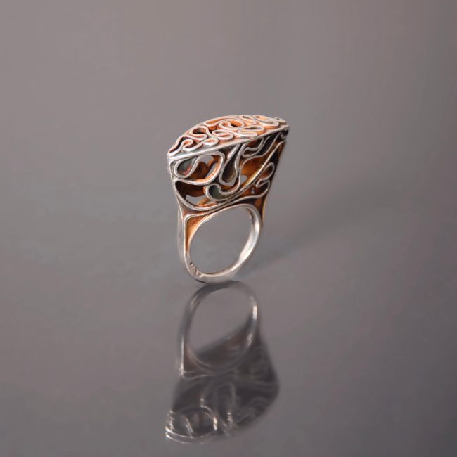 Escape II, ring by Victoria Lansford; photo by Pat Vasquez-Cunningham