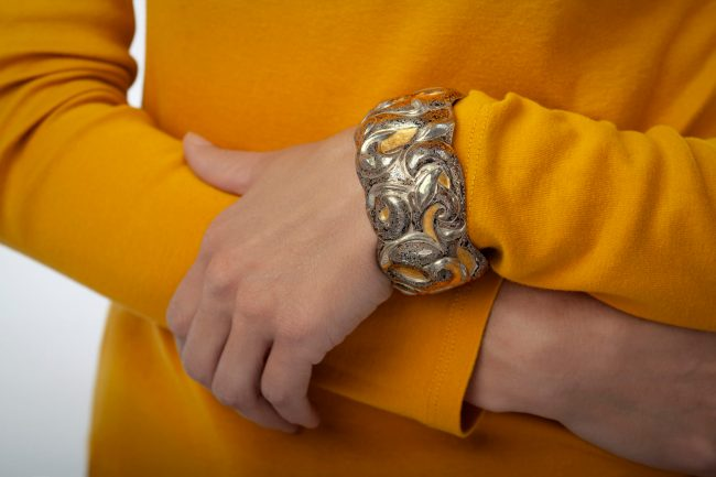 Mysteries Entwined, Eastern repousse cuff by Victoria Lansford; photo by Pat Vasquez-Cunningham