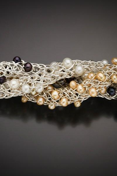 Three Ariadne's Thread bracelets with natural peach, white or purplish blue pearls; photo by Pat Vasquez-Cunningham