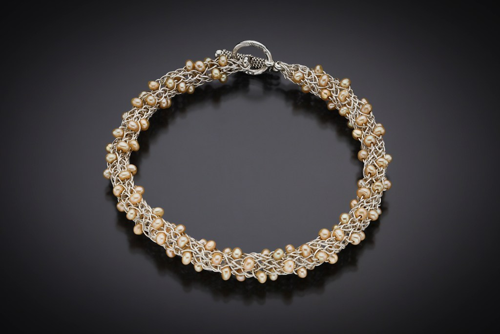Ariadne's Thread bracelet with natural peach pearls; photo by Pat Vasquez-Cunningham