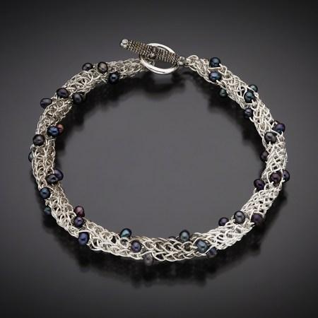 Ariadne's Thread bracelet with natural purplish blue pearls; photo by Pat Vasquez-Cunningham