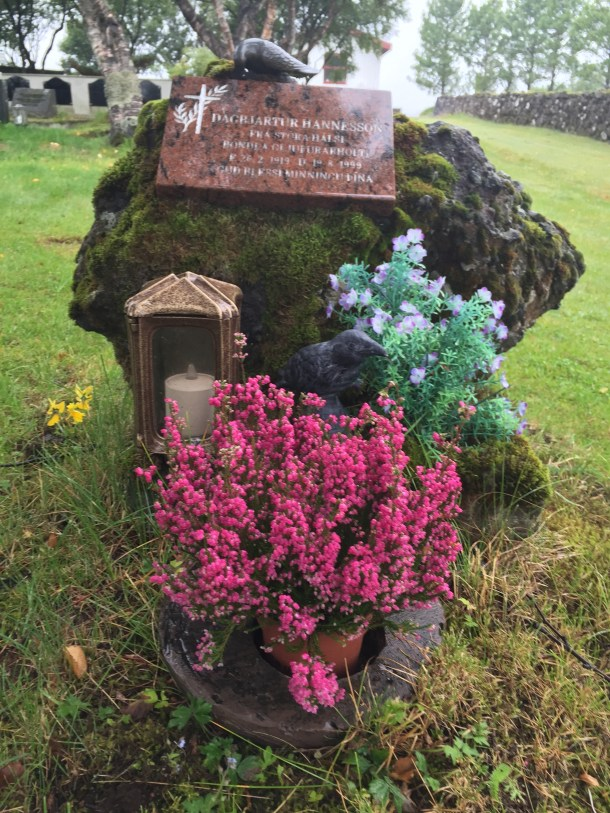 Nevermore amidst thee flowers on a grave at Kotstrandarkirkja near Selfoss.