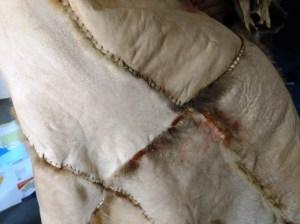 how possum cloak is stitched together