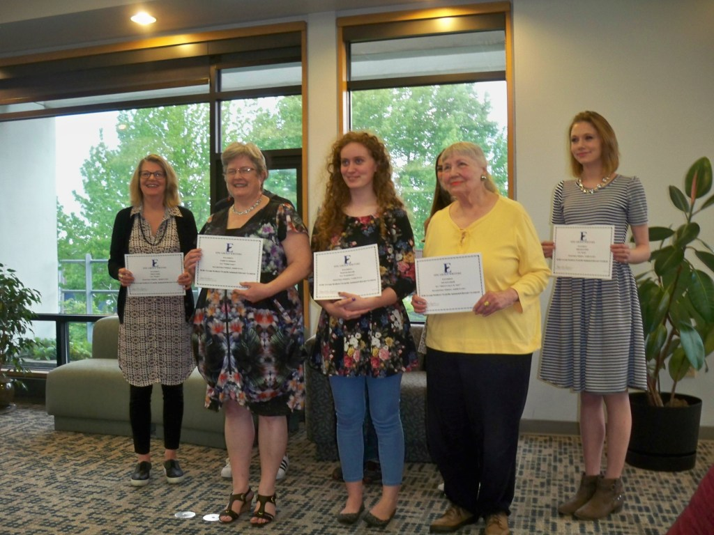 image of 2016 EPIC Group Writers' writing contest winners. Victoria is picture in the center of the front row