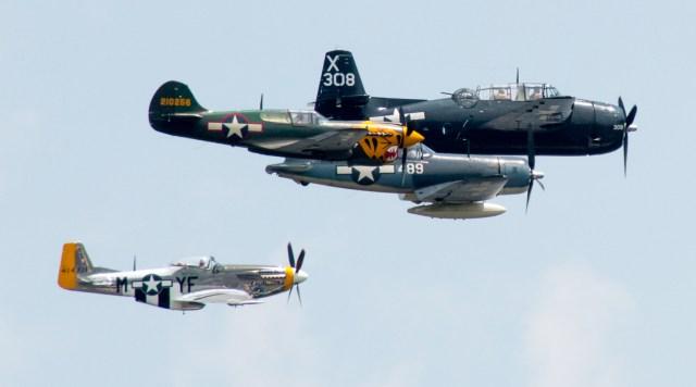 Arsenal of Democracy Flyover, Washington D.C. 2015. 70th Anniversary of VE Day. The Missing Man formation. Grumman TBM Avenger, Vought F4U Corsair, Curtiss P-40 Warhawk, North American P-51 Mustang