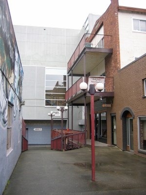 laneway before redevelopment: at grey wall, pedestrians needed to go left then right again to get through