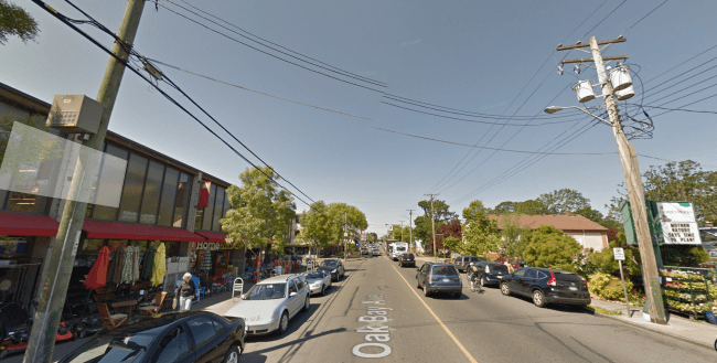 "Oak Bay Avenue: two parking lanes, two wide driving lanes - and bikes ride the ""door zone"" between rows of cars."