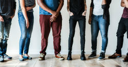 diverse youth standing in circle
