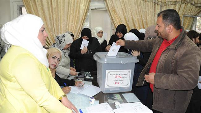 This photo, taken on April 13, 2016, in the Syrian capital, Damascus, shows a voting poll for Syrian parliamentary elections. (Photo by SANA)