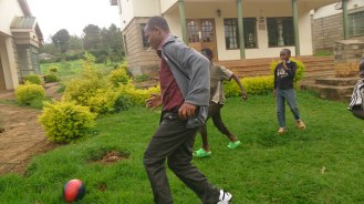 Rotich engaging the kids in a football game