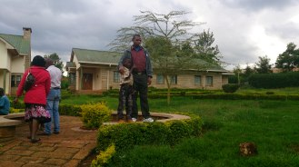 My colleague Rotich posing with one of the kids