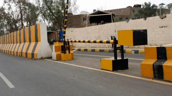 Concrete barriers are seen at the entrance to the Sheraton Hotel where U.S. diplomats and members of the embassy are residing in Sanaa .