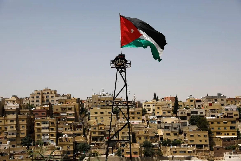 A Jordanian flag flies above Amman. (AFP)