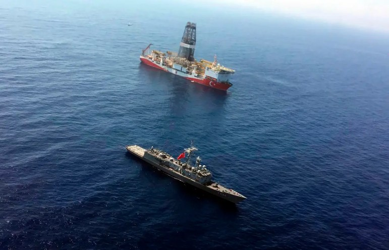 A Turkish Navy warship patrols on July 9, 2019, near Turkey's drilling ship Fatih that is making its way towards the eastern Mediterranean near Cyprus. (AP)