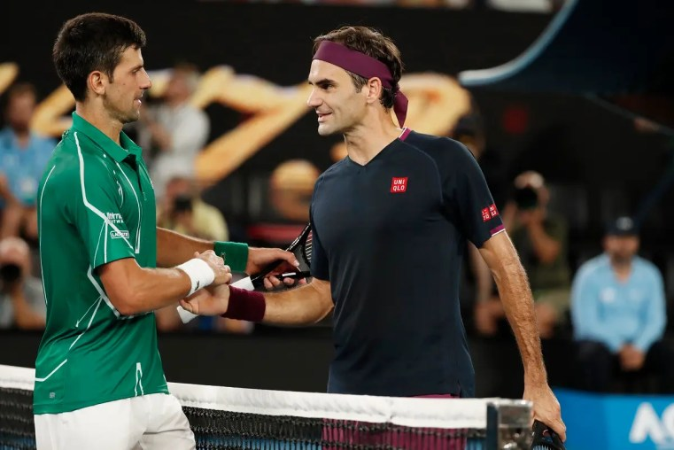 Serbia's Novak Djokovic and Switzerland's Roger Federer shake hands after their Australian Open match on January 30, 2019, in Melbourne. (Reuters)
