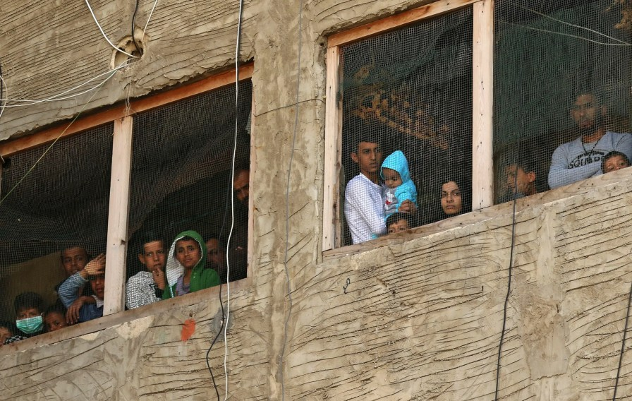 Syrian refugees in a building under construction they have been using as a shelter in the city of Sidon in southern Lebanon, on March 17, 2020. (File photo: AP)