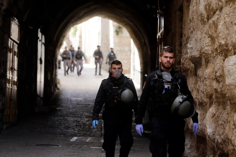 Israeli police patrol deserted street in Jerusalem's Old City, in Jerusalem on March 23, 2020. (AP)
