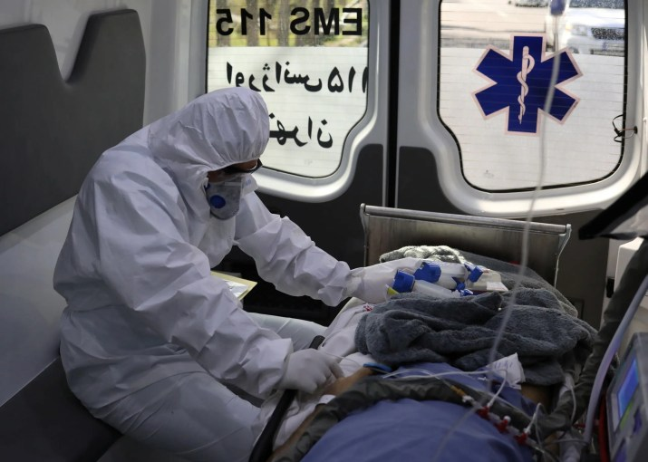 A member of emergency medical staff wearing protective suit, sits in an ambulance while transferring a patient with coronavirus disease (COVID-19) to Masih Daneshvari Hospital, in Tehran, Iran March 30, 2020. (Reuters)