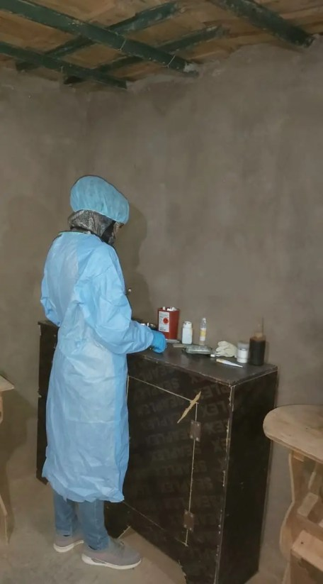 A nurse looks over a small supply of medicine in the camp. (Supplied: Abu Abdullah)