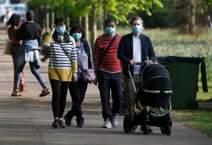 People hiking in London wearing masks