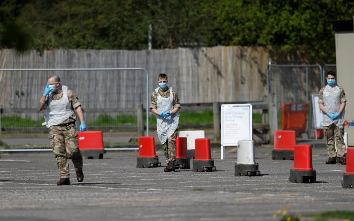 Military personnel in front of a London development center to undergo corona examination