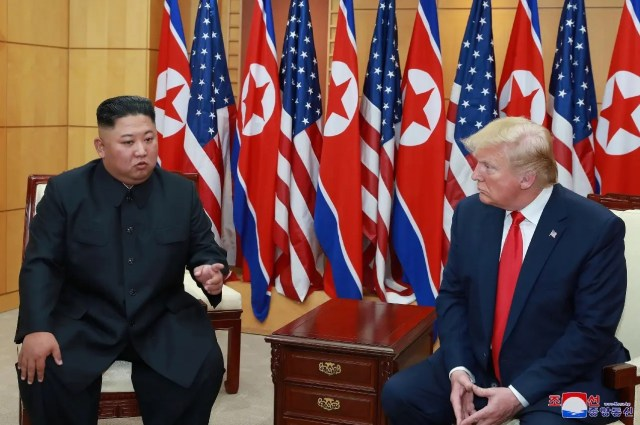 US President Donald Trump speaks with North Korean leader Kim Jong Un during a meeting at the demilitarized zone separating the two Koreas, in Panmunjom, South Korea, June 30, 2019. (Reuters)