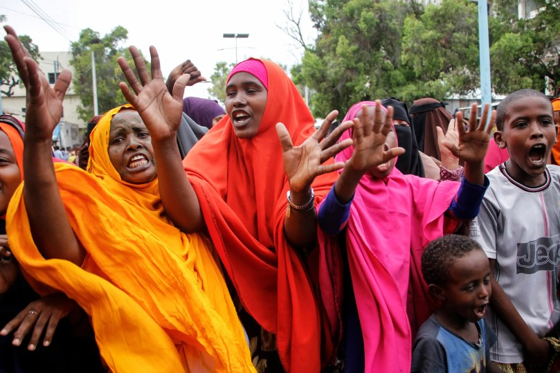 Somali women protest against the killing Friday night of at least one civilian during the overnight curfew, intended to curb the spread of the new coronavirus, on a street in the capital Mogadishu, Somalia on April 25, 2020. (AP)