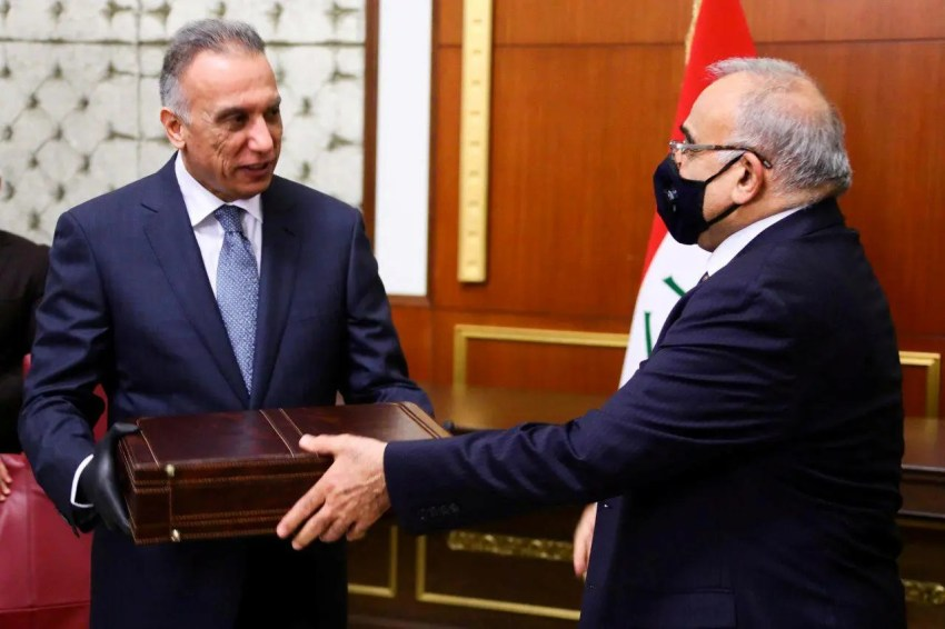 Former Iraqi Prime Minister Adel Abdul Mahdi hands over to new Prime Minister Mustafa al-Kadhimi in Baghdad. (Reuters)