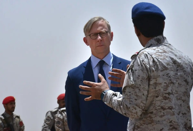 Brian Hook (L), the US special representative on Iran, listens to a member of the Saudi military forces at an army base in al-Kharj, south of the Saudi capital Riyadh, on June 21, 2019. (AFP)
