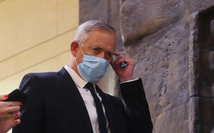 Blue and White party leader Benny Gantz, wearing a protective face mask, arrives for the swearing-in ceremony at Israel's parliament, the Knesset, in Jerusalem, on May 17, 2020. (AFP)