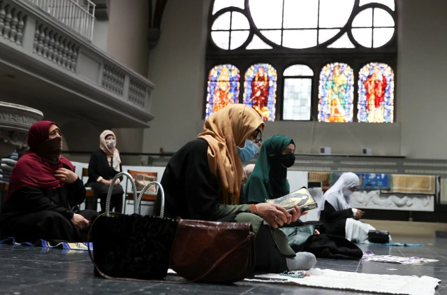 Muslims pray inside the evangelical church of St. Martha's parish, during their Friday prayers, amid the coronavirus outbreak in Berlin, on May 22, 2020. (Reuters)