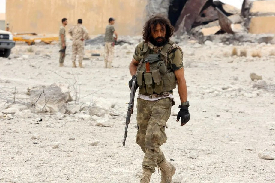 Member of Libya's GNA holds his weapon after taking control of Watiya airbase. (Reuters)