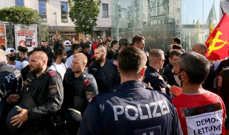 Police separate Kurds and Turkish demonstrators during a Kurdish demonstration against Turks in Vienna, Austria, Saturday, June 27, 2020. (AP)